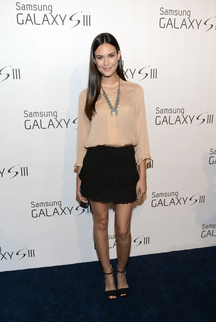 Odette Annable styled up an easy look for a Samsung event with a silky button-down and statement jewels.
