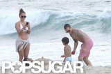 Jennifer Lopez played on the beach in Rio de Janiero with Casper Smart, Max, and Emme in June.