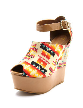 The tribal vibe hit the runways hard this season, and these wedges will give a boho-cool appeal to your warm-weather wardrobe. Charlotte Russe Patent Trim Tribal Print Wedge ($43)