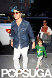 Matthew McConaughey led the way for his little guys as the family checked into their Manhattan hotel.