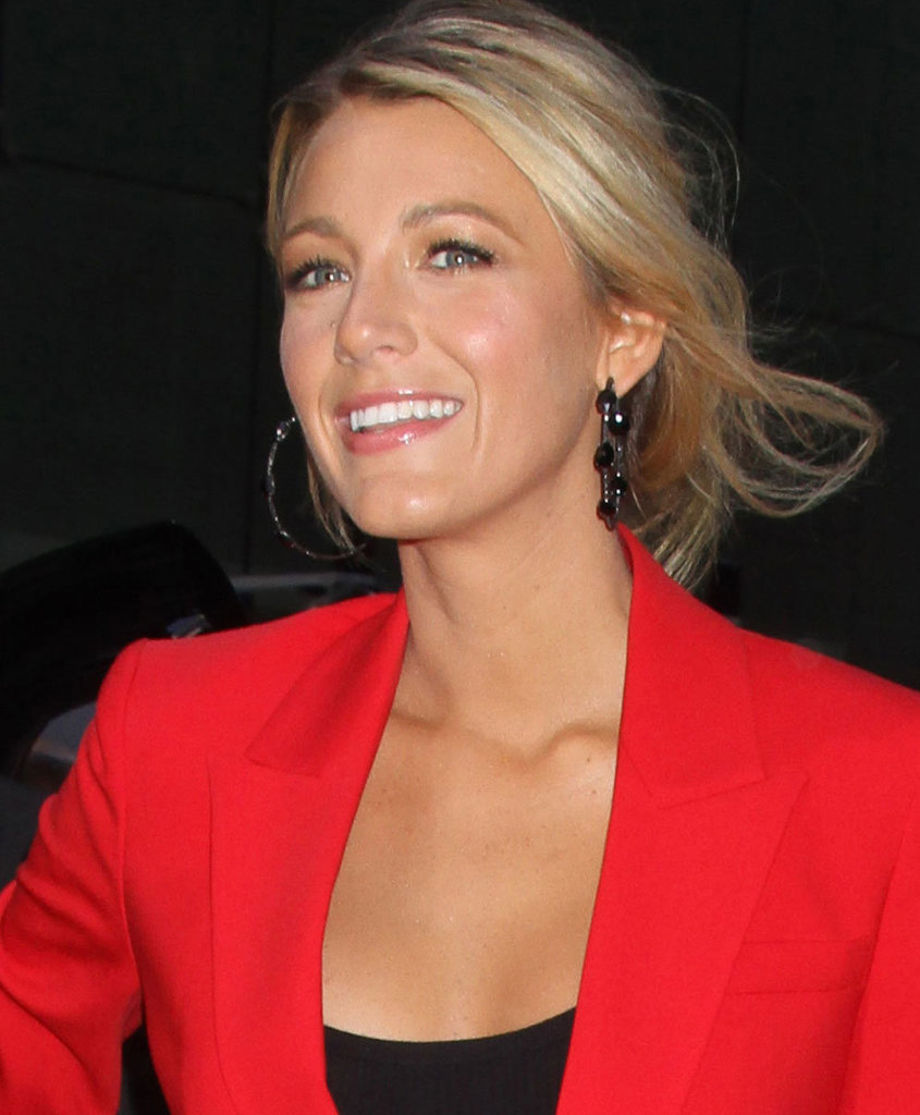 Blake Lively added glamour to her look with a pair of black jewel-drop earrings.