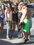 Selena Gomez and Taylor Swift posed with fans in Malibu.