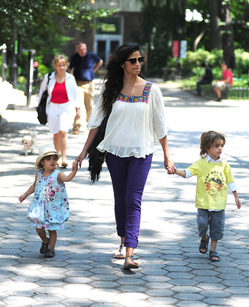 Camila held tight to both of her kids as they spent the day in NYC.