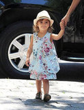 Vida McConaughey looked adorable in a floral dress and hat.