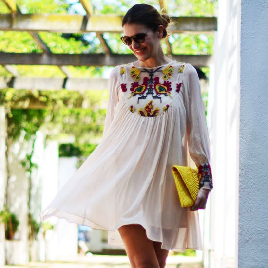 Pair a sheer feminine tunic dress with bright accessories. Photo courtesy of Lookbook.nu