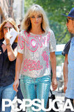 Miranda Kerr was sparkling in a silver and hot pink shirt and bright blue pants.