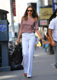 Miranda Kerr's second look could make jaws drop just about anywhere — and all it took was a pair of perfect-fit white denim and a printed blouse.