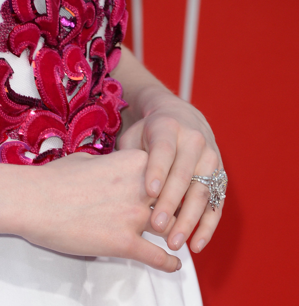 A closer glimpse of Emma's Chanel reveals a beautifully ornate bodice — we also get a peek at Emma's shimmering ring.