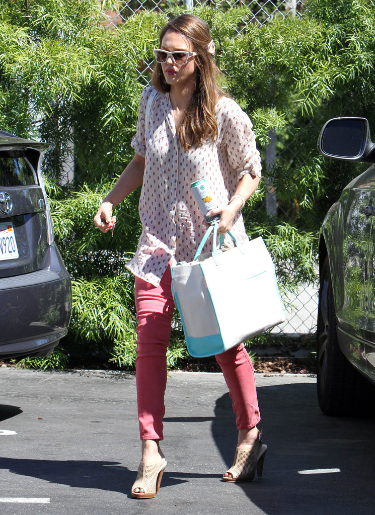 Jessica Alba punched up her casual look with red pants and a printed blouse.
