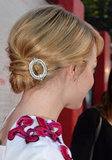Emma finished her swept-back bun with just the right amount of sparkle on her hair pin.