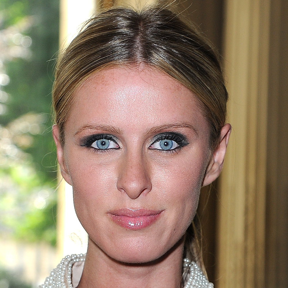 What can we say about Nicky Hilton's eyes except for WOW. Her crystal blue sparklers were beautifully accentuated with a soft, smoky eye front row at Valentino in Paris this week. To get her look at home, build layers an eyeshadow palette. We love POP Lid Monochrome (approx $23.81).