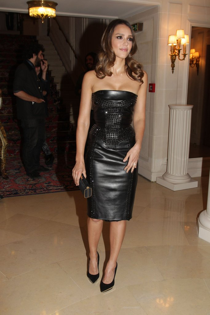 Jessica Alba looked chic in a tight black leather dress at the Versace fashion show in Paris.