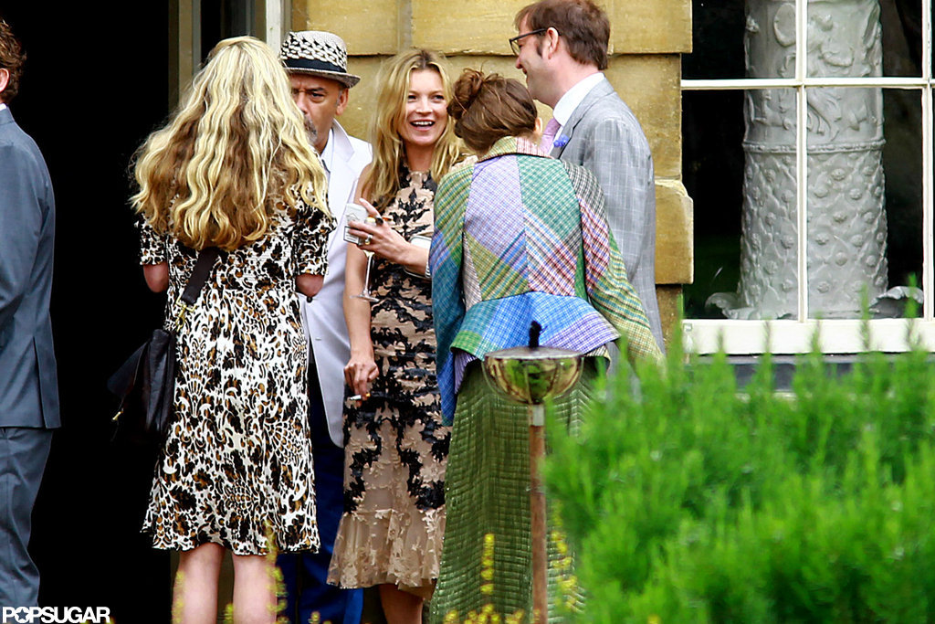 Kate Moss laughed with a group of friends including Christian Louboutin.