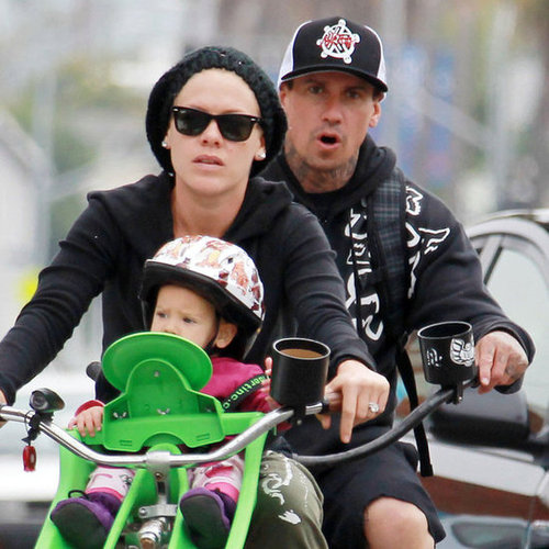 Pink Riding Bikes With Her Family