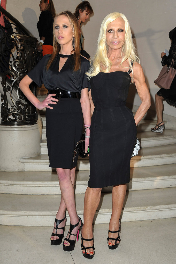 Allegra Versace and Donatella Versace struck a pose at the entrance of the Christian Dior show in their respective curve-hugging black looks.