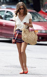 Olivia Palermo's silky blouse and printed shorts got a casual kick via a raffia carryall by Gerard Darel.