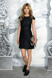 Clémence Poésy struck at pose at the Chanel photo call in Paris.