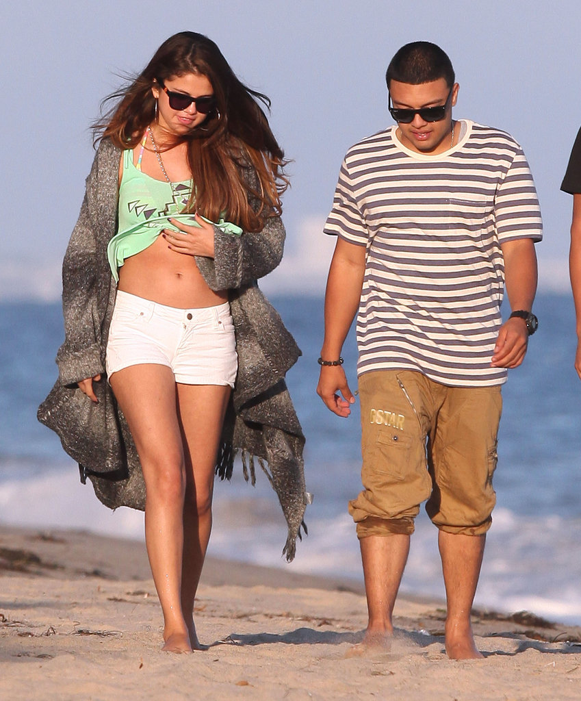 Selena Gomez showed off her abs on the beach in Malibu with friends.