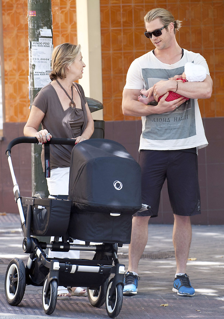 Chris Hemsworth held India in his arms for a walk around Madrid with his mother-in-law.