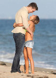 Ashley Tisdale and Scott Speer showed PDA on the beach in Malibu for her birthday.