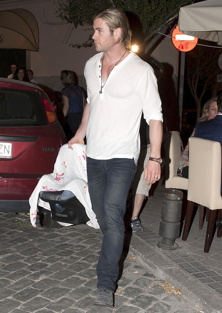 Chris Hemsworth carried India in a baby carrier in Madrid.
