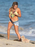 Ashley Tisdale wore denim shorts and a bright green bikini on her birthday.