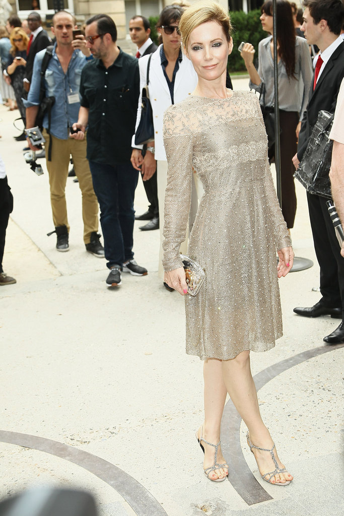 Leslie Mann struck a pose in a metallic-tinged sheath dress at Valentino.