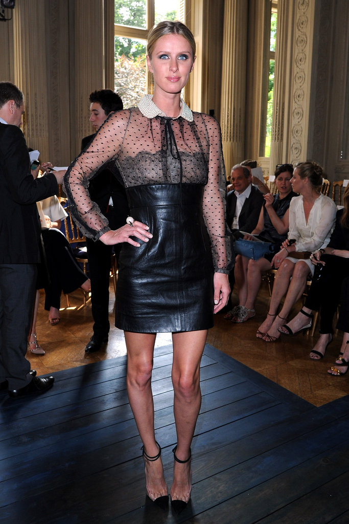 Nicky Hilton balanced leather with girlier details in a Valentino ensemble at the label's Couture show.