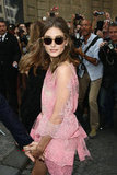 With cat-eye shades to complement her day-glam Couture, Olivia turned heads on her way into the show.