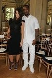 Kim Kardashian and Kanye West made an appearance in color-coordinated black and white looks at Valentino.