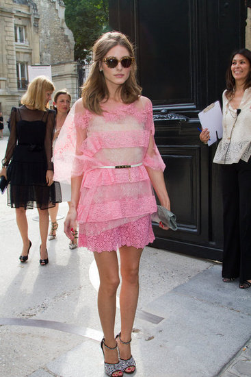 Poised, polished, and delightfully girlie: Olivia showed off her lovely pink Valentino dress and glittering Giuseppe Zanotti ankle-strap heels.