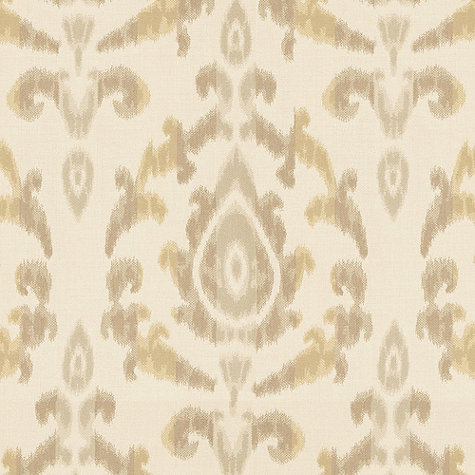 If you're looking to introduce a subtle pattern, then consider a neutral print like the one on this Como Ikat Dijon Sunbrella Fabric ($38 per yard).