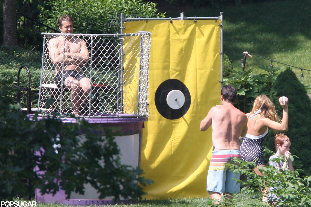 Blake Lively dunked a shirtless Ryan Reynolds in a dunk tank on the Fourth of July.