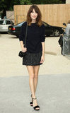 Alexa Chung stuck to her easy-chic style formula in a tweedy mini and a slouchy knit outside the Chanel show.