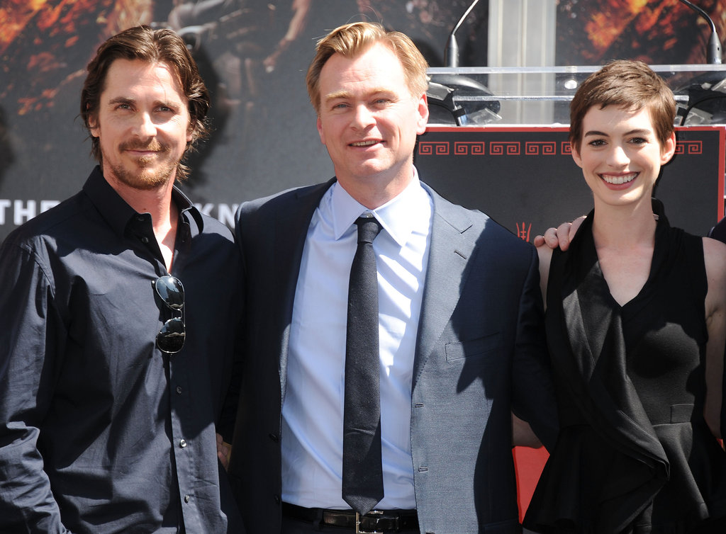 Anne Hathaway and Christian Bale posed with Christopher Nolan at his hand and footprint ceremony in LA.