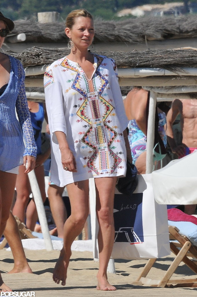 Kate Moss showed off her legs in a short white cover-up.