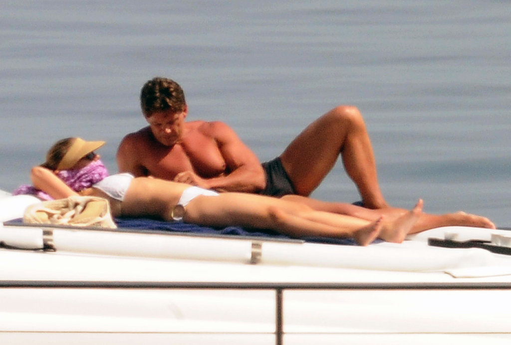 Scarlett Johansson laid out on a yacht with a male companion by her side.