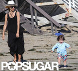 Rachel Zoe wore a long black maxi dress and hat for a day on the beach with Skyler.