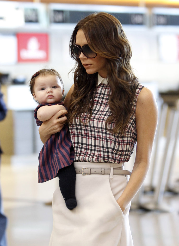 Victoria and Harper Beckham wore color-coordinated outfits while jetting out of LAX in November 2011.
