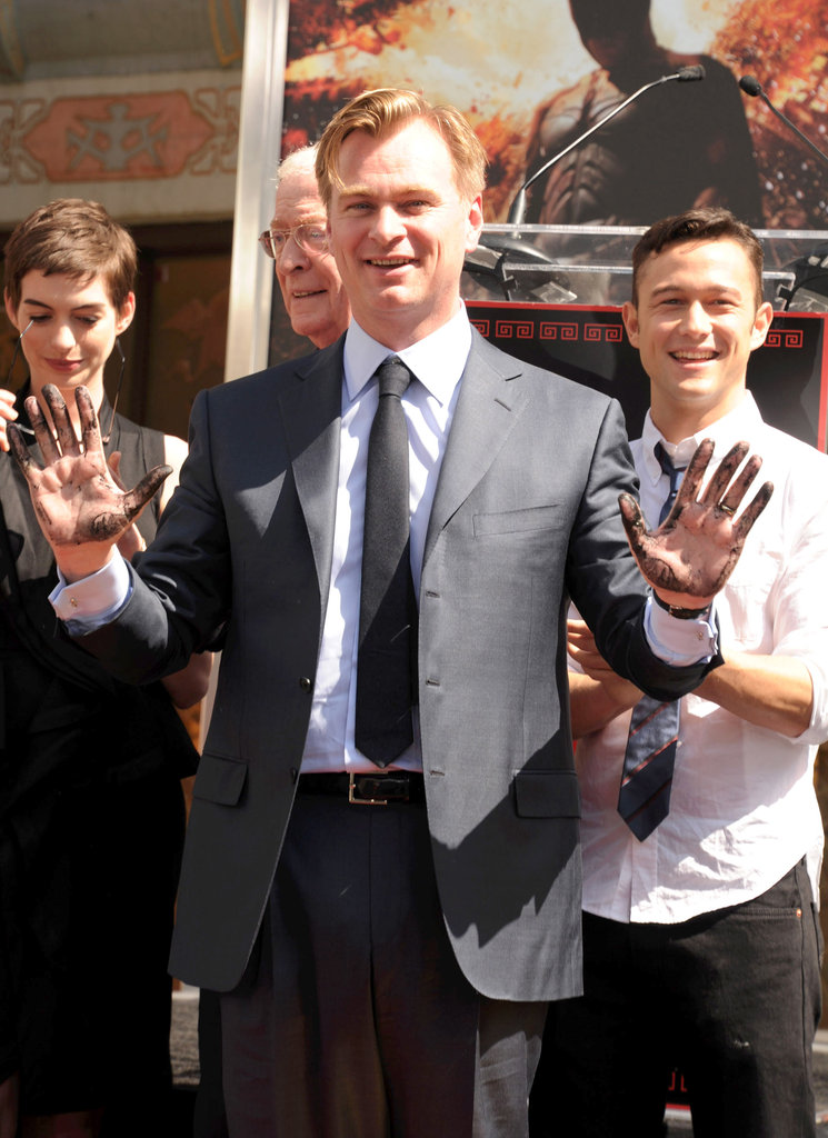 Christopher Nolan was supported by Anne Hathaway, Joseph Gordon-Levitt, and Michael Caine, who were in attendance at his hand and footprint ceremony in LA.