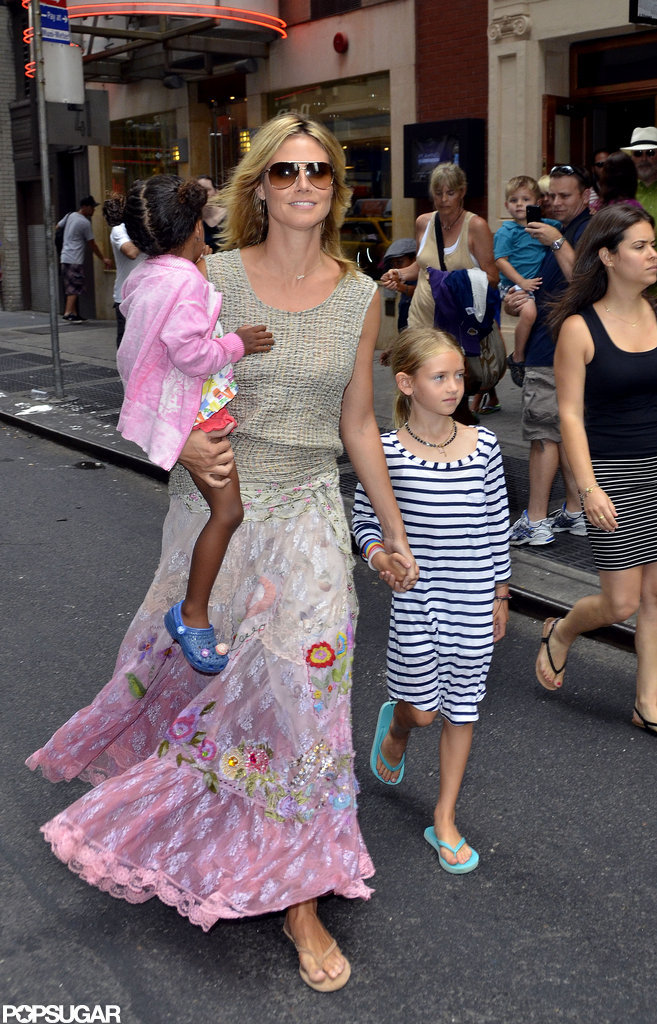 Heidi Klum looked happy as she held on to her little ones while spending the day in Times Square.