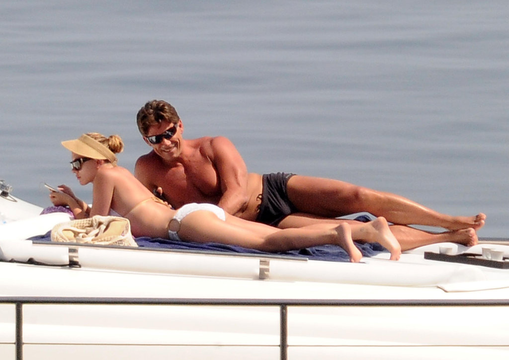 Scarlett Johansson got her tan on in a white bikini while floating around Sicily in July.