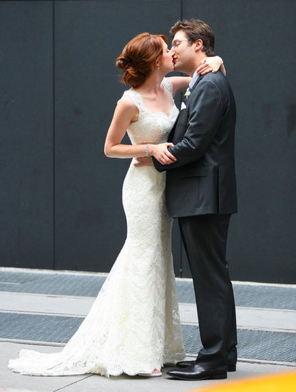 Ellie Kemper and husband Michael Korman kissed.