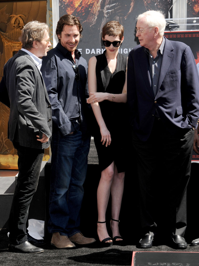 Anne Hathaway, Michael Caine, Gary Oldman, and Christian Bale had a laugh together at Christopher Nolan's hand and footprint ceremony in LA.