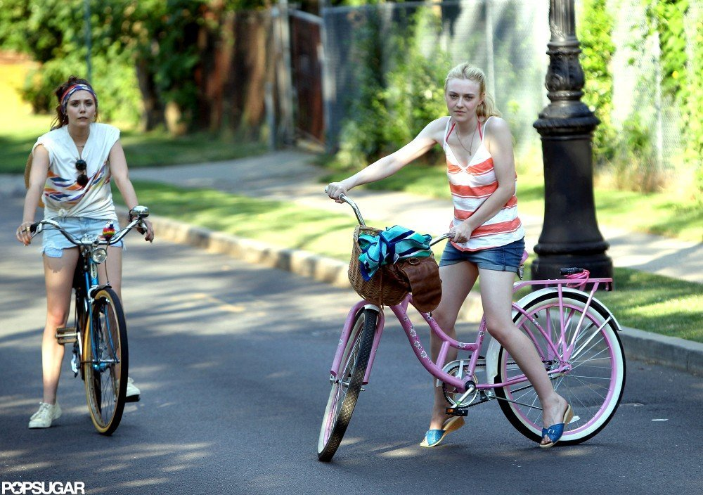 Dakota Fanning turned her bike around.