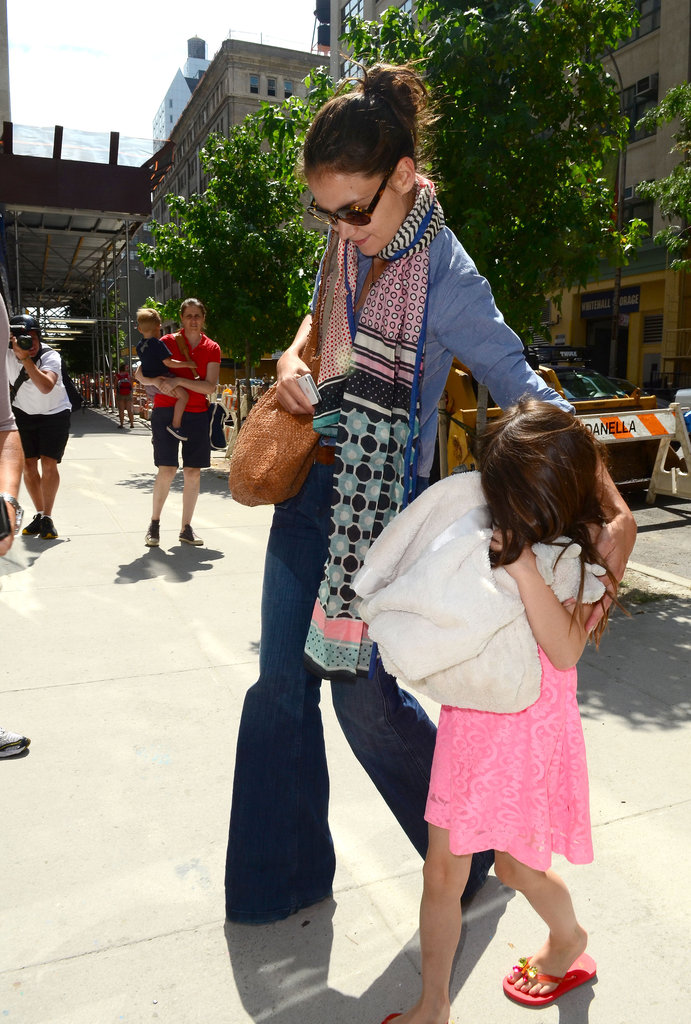 Katie Holmes and Suri Cruise went out as news of Katie Holmes and Tom Cruise's divorce settlement was released.