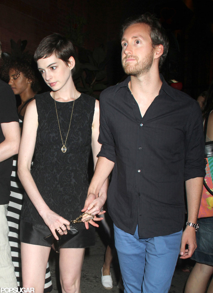 Anne Hathaway held hands with Adam Schulman at the Shut Up & Play the Hits screening in NYC.