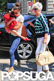Katie Holmes carried Suri Cruise as they arrived at the zoo in Central Parl.