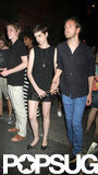Anne Hathaway was arm-in-arm with fiancé Adam Schulman for the Shut Up & Play the Hits screening in NYC.