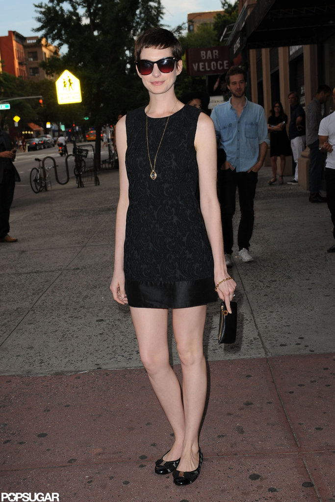 Anne Hathaway smiled as she arrived for the Shut Up & Play the Hits screening in NYC.